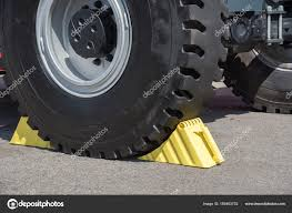 Yellow Wheel Chocks Under The Big Truck Wheels — Stock Photo © Vox19 ... Dock Chock Truck Wheel Video Dailymotion Aerhock 20 National Plastics Rubber Motorcycle Stand Harley Davidson Tire Road Mount Floor Yellow Wedge Under Tyre Stock Photo 378748 Vestil Mounted Holder For Rwc8tmchrwc8 The Checkers Urethane Discount Ramps Condor Pitstoptrailer Stop Ps1500 Dirt Bike Yellow Wheel Chock Wedge Under Truck Tyre 48378746 Alamy Amazoncom Camco Rv With Padlock Stabilizes Your Basic Use And Safety Tips Jual Harga Murah Bogor Oleh Pt Kakada Pratama 2 Wheel Chocks Leveling Block Blocks Car Rv Camper