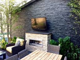 Patio With A Fireplace And A Gas Grill In Chicago
