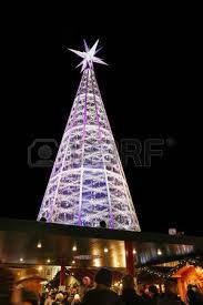 People Walking At Christmas Market With A Huge Swarovski Crystal Tree Visible In Innsbrucks Marktplatz
