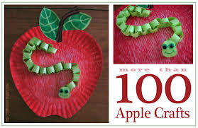 A Worm Crafted From Paper Chain Wiggles His Way Down The Face Of Vividly Colored Apple With Combination Several Ordinary Tools Plus