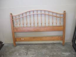 64 x 45 solid maple queen bed has arched headboard and footboard