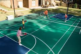 Bring The Game Home With A Backyard Sports Court | HGTV Backyard Basketball Court Multiuse Outdoor Courts Sport Sketball Court Ideas Large And Beautiful Photos This Is A Forest Green Red Concrete Backyard Bar And Grill College Park Go Green With Home Gyms Inexpensive Design Recreational Versasport Of Kansas 24x26 With Canada Logo By Total Resurfacing Repairs Neave Sports Simple Hoop Adorable Dec0810hoops2jpg 6 Reasons To Install Synlawn Small Back Yard Designs Afbead