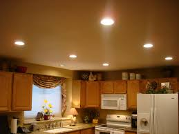 lovely small kitchen ceiling light above big wooden cabinet on