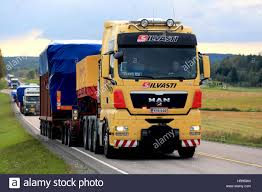 JAMSA, FINLAND - SEPTEMBER 1, 2016: Yellow MAN V8 Semi Truck Hauls ... 44 Historical Photos Of Detroits Fruehauf Trailer Companythe Mack Trucks Wikipedia The Tesla Semi Will Shake The Trucking Industry To Its Roots Samsungs Invisible Truck That You Can See Right Through Fortune Biggest Rig Ever Youtube Nikola Corp One Truck602567_1920 First Capital Business Finance Interior Video Shows Life A 20 Trucker Old Trucks Being Loaded Onto Railroad Cars Long Haul Navistar Will Have More Electric On Road Than By Jamsa Finland September 1 2016 Yellow Man V8 Semi Truck Hauls Selfdriving Freightliner Inspiration From Daimler