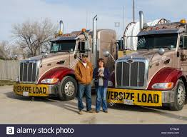 Foreign Truck Drivers Pose Beside Their 'Watt And Stewart' Canadian ...