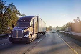 18 Wheeler Semi Truck On Highway With Sun Lens Flare - Shipware