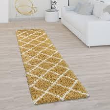 teppich wohnzimmer hochflor shaggy skandi design mit rauten muster modern in gelb