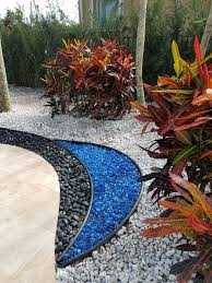 Blue Glass Polished Black Stone White Marble Chip With Colorful Crotons Against An