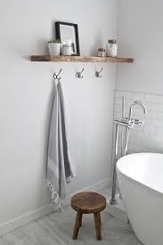 A Wooden Floating Shelf Adds Texture To The Bathroom Decor