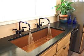 Trough Sink With Two Faucets by Attractive Double Faucet Bathroom Sink And Bathroom Brown Double