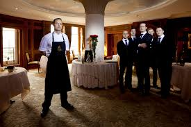 chef de cuisine hendrik ottto and his service team in their