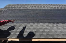 what are the pros and cons of tesla s new solar roof tiles