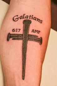 Cool Cross Tattoo On A Guys Arm