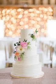 Wedding cakes don t have to have traditional flowers why not try adding some bold and bright hues as cake decor