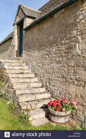 External Steps On A Stone Barn In The Cotswold Village Of Yanworth ... Historic Hay Barn With Red Oak Timber Frame Bedford Glens Reclaimed Stone Barn Wall Detail Stock Photo Royalty Free Image 13736040 Walls Ace Brick And Stonework Stemasons Old Dakotas Stone Foundation Constructing The Filefox 3jpg Wikimedia Commons Rockin Walls Got Realgoods Company Natural Chunks Frank Brothers Landscape Supply Inc Barnstone Rolling Rock Building Made Into A House Kipp Heritage
