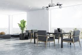 Corner Of Modern Dining Room And Living Room With White Walls,..
