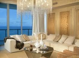 living room with crown molding chandelier in boca raton fl
