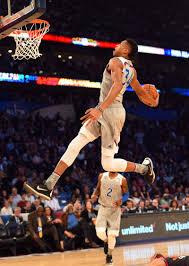 Milwaukee Bucks Giannis Antetokounmpo dunks over Chicago Bulls