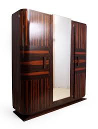 Art Deco Macassar Ebony Armoire, 1920s For Sale At Pamono Emejing Armoire Art Deco Photos Transfmatorious Midcentury With Cedar Closet By Tribond Voyage Of An Kindredvoyages Sold Italian 1930s Vintage Wardrobe Or B491 Mahogany Cpactom Fitted Beautiful Burl Bakelite Handles At 1stdibs French Nouveau Maple And Inlaid Armoire Tanguy 1931 The Proteus Yves Pinterest Old World Complete In Warm Pomegranate English Faux Bamboo On Chairishcom Biscayne