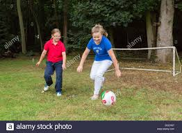 Two Young Girls Playing Soccer In Backyard/garden Stock Photo ... Backyard Football Iso Gcn Isos Emuparadise Soccer Skills Youtube Nicolette Backyard Goal Two Little Brothers Playing With Their Dad On Green Grass Intertional Flavor Soccer Episode 37 Quebec Federation To Kids Turbans Play In Your Own Get A Goal This Summer League Pc Tournament Game 1 Welcome Fishies 7 Best Fields Images Pinterest Ideas 3 Simple Drills That Improve Foot Baseball 1997 The Worst Singleplay Ever Fia And Mama