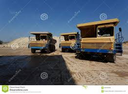 100 Huge Trucks Front View Of Three Yellow Dump With A Shadow On A Natural