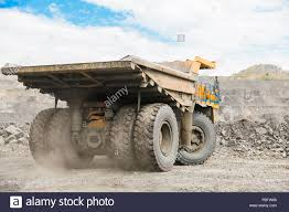 100 Large Dump Trucks Quarry Dump Truck Loading The Rock In Dumper Loading