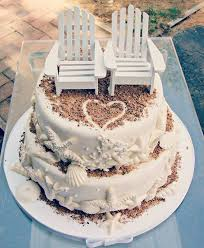 Pretty Beach Wedding Cake With Cute Chair Toppers