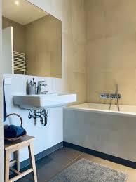 badezimmer badewanne minimalistisch grau mokka