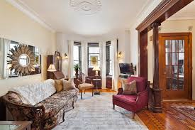 In The Living Room Oak Fluted Columns And An Paneled Divider Leading Into A Parlor With Decorative Marble Fireplace Staircase Framed