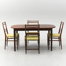 A Stained Teak Dining Table With Four Chairs, JOC, 1960's. - Bukowskis Niels Otto Mller Two Ding Room Chairs Model No 85 Teak And 1960s Ercol Grand Windsor Ding Table Eight Chairs Teak Set For Sale At Pamono Three Room Total 3 Movietv Lot Chair Scdinavian Design Style Cover Etsy 8 Vintage Armchairs Burgess Parker Fler Heywoodwakefield With Six Usa At 1stdibs Sarah Potter Midcentury Modern Fniture 4 From Gplan For Sale Scandart Vintage Mid Century 1960 S Golden Elm Extending Uhuru Fniture Colctibles Sold Kitchen