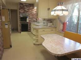1950s kitchen with built in booth needs tlc