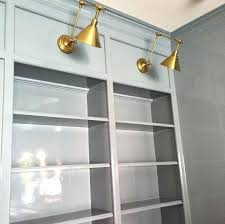 library bookcase lighting magnificent swing arm wall l in
