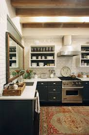 Graphic Black And White Kitchen Paired With Beautiful Rug
