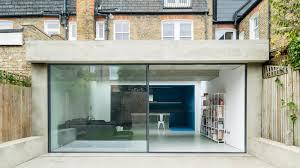bureau d change extension by bureau de change has blue kitchen and white lounge