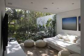 Natural Bedroom With Clear Glass Separator