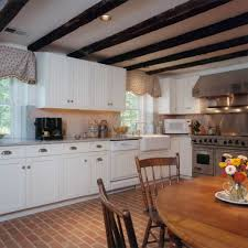 kitchen with brick floors and white cabinets brick floor care