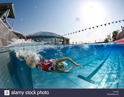 A Female Swimmer Training In An Open Air Olympic Swimming Pool France Underwater View
