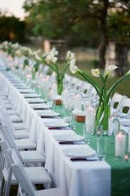 Banquet Tables Put Together White Wedding Chairs Polyester Linens With A Crushed Green Runner