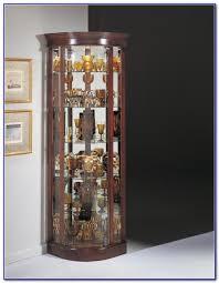 pulaski golden oak console curio cabinet download page best home