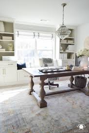 Crystal Chandelier Over Table Desk In Office Front Of Windows And Built Cabinets Home