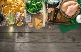Download Raw Ingredients For Cooking Italian Pasta On Wooden Table Stock Image