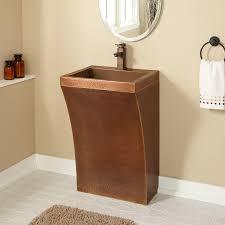curved hammered copper pedestal sink bathroom