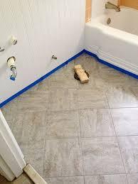 amazing remodelaholic bathroom redo grouted peel and stick floor