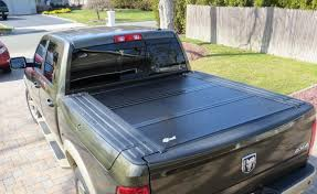 Rambox Bed Cover by Bak Bakflip F1 Folding Tonneau Cover 2009 12 Dodge Ram 1500 5 5ft
