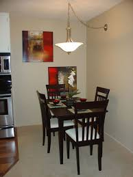 Dazzling Small Asian Style Dining Room With Black Wood Sets Also Antique White Hanging Lamp Plus Colorful Canvas Wall Art Complete Orchid Flower