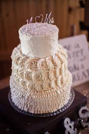 Skylor And Austins Wedding Cake A 3 Tiered 10 Inch 8 6 With Ruffles Rosettes Rustic Style Buttercream Icing