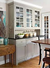 The Pleasing Blend Of Traditional Cabinetry With Modern Warm Gray Paint Creates A Clean Casual And Comfortable Kitchen At