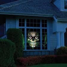 Halloween Ghost Projector by The Holiday Window Scene Animator Hammacher Schlemmer