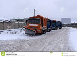A Column Of Five Snow-remover Trucks On The Road In Winter During A ...