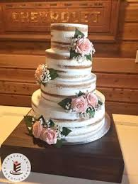 Wedding Cake Loveliness A Naked Style With Artificial Flowers On Dark Wood